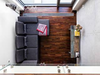 Loft z intensywną czerwienią : styl , w kategorii Salon zaprojektowany przez Decoroom