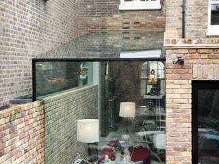 Side Return Frameless Glass Extension. London: modern Conservatory by Maxlight