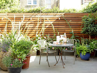 Jardines de estilo  por Cue & Co of London