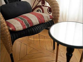Haussmanien et Design Salon moderne par ATELIER FB Moderne