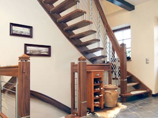 Rustic style corridor, hallway & stairs by STREGER Massivholztreppen GmbH Rustic