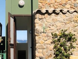 Nano Casa:  in stile  di Concreta di Alessandro Rocca