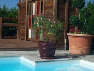 Pergola, pool house FA'BRIC ET BOIS Balcon, Veranda & Terrasse originaux