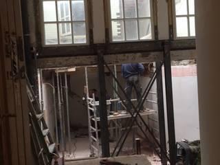 Achterhuis gevel ingekort lichthof dak verwijderd:  Winkelruimten door Axel Grothausen BNI