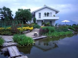 Piscinas rurales de Paul Marie Creation Garden Design & Swimmingpools Rural