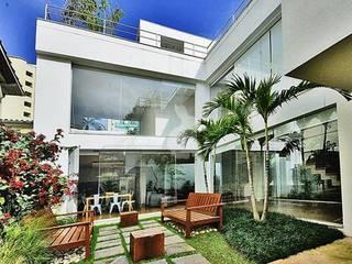 Casa Campo Belo - SP: Casas  por Barbara Filgueiras arquitetura,Moderno