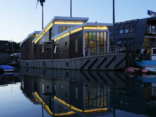 Floating Office on a 1941 WWII Ferro Cement Barge:  Office buildings by Märraum