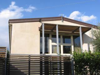 Lato Sud: Case in stile in stile Moderno di Studio Architettura x Sostenibilità