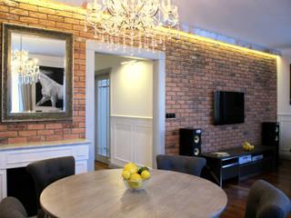 W stylu paryskiej kamienicy Eklektyczny salon od Pracownia Projektowa Pe2 Eklektyczny