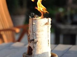Candle Logs make a great outdoor evening party. van Greige Scandinavisch