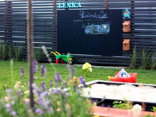 """Ogród """"Poza miastem"""": styl , w kategorii Ogród zaprojektowany przez Miejskie Ziele"""
