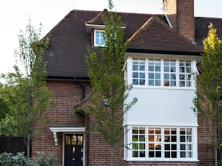 Rotherwick Road - Hampstead Garden Suburbs 'Arts & Crafts' House Modern houses by TG Studio Modern
