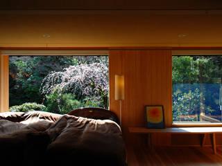 岩田坂の増築: ELEPHANTdesignが手掛けた寝室です。