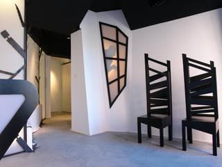 TATTOO ADICTS - Visión general de la entrada del estudio: Espacios comerciales de estilo  de euskaldiseinu estudio