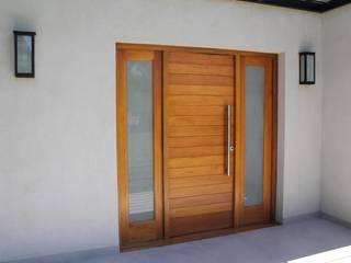Puertas y ventanas de estilo moderno de ApConstrucciones Moderno