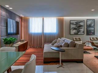 Apartamento KV: Salas de estar  por Gláucia Britto