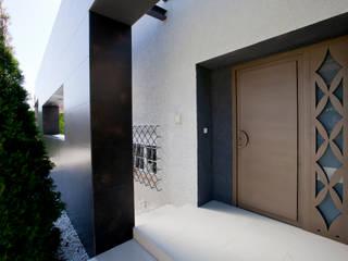 Maisons rustiques par IPUNTO INTERIORISMO Rustique