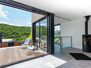 Minimalist living room by Hugues TOURNIER Architecte Minimalist