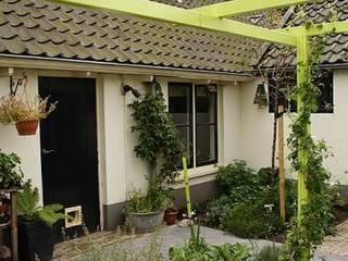 Modern Garden by Dutch Quality Gardens, Mocking Hoveniers Modern