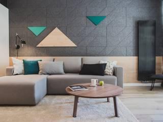 Salas de estar modernas por Raca Architekci