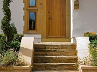 Front Entrance: country Houses by Wildblood Macdonald