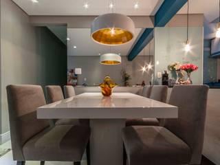 Condomínio Portal de Barcelos : Salas de jantar  por Lo. interiores