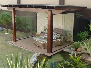 Jardines de estilo tropical de Flávia Brandão - arquitetura, interiores e obras Tropical