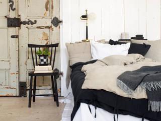 Dormitorios de estilo  por Nyblom Kollén AB