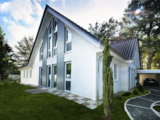 Country style houses by Haacke Haus GmbH Co. KG Country