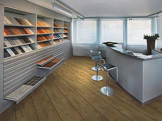 SUELOS Y PAREDES SIN OBRAS Modern offices & stores