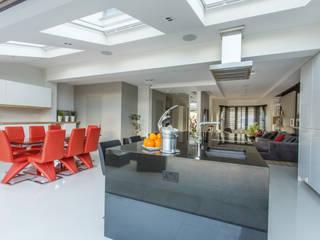 Open plan kitchen:  Kitchen by GK Architects Ltd