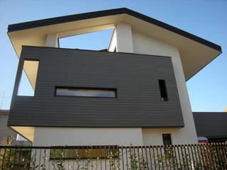 Poloni: Villa Privata: Case in stile in stile Moderno di Poloni