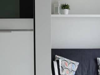 Kawalerka 25m2: styl , w kategorii Salon zaprojektowany przez Architektownia