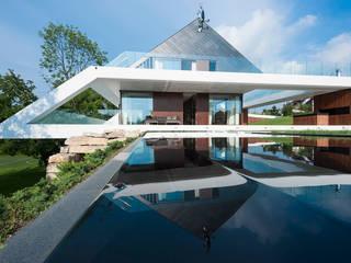 MOBIUS ARCHITEKCI PRZEMEK OLCZYK Casas de estilo moderno