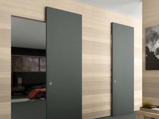 Scorrevole esterno muro senza binario a vista : Finestre & Porte in stile in stile Minimalista di Phi Porte