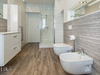 Wnętrze łazienki, Kęty Nowoczesna łazienka od TIKA DESIGN Nowoczesny