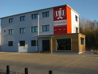 Bürogebäude im Passivhaus-Stadard mit Lagerhalle: industriale Häuser von passivbau Blohm Wohn- und Gewerbebau GmbH&Co.KG