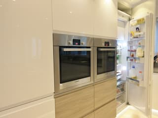 Large fridge located in bank of towers next to the ovens. Kitchencraft Dapur Modern