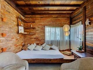 Casa ReFit: Salas de estar  por Ferraro Habitat,Rústico