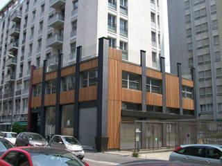 Rivestimento Edificio nel centro di Milano.: Spazi commerciali in stile  di Arcadia Biocase - Casattiva +