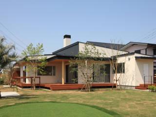 Moderne Häuser von TAMAI ATELIER Modern