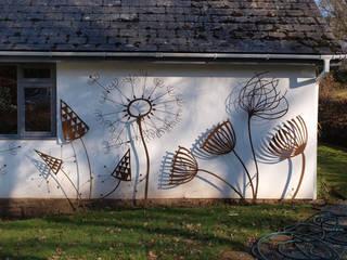 Wall mounted sculptures Modern garden by artinsteel Modern