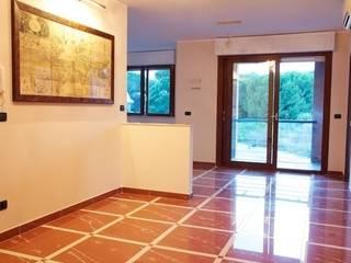 Ristrutturazione appartamento: Soggiorno in stile  di m2b2studio