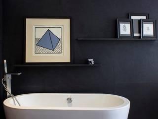 Departamento KL: Baños de estilo  por Concepto Taller de Arquitectura