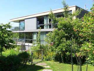 1-3 Familienhaus Eierbrecht, Zürich eidenbenz.architekt Moderne Häuser