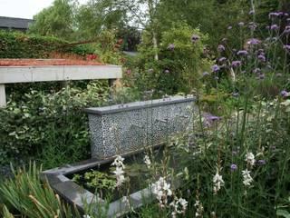 Weelderig: moderne Tuin door Ontwerpstudio Angela's Tuinen