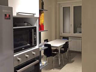 cucina: Sala da pranzo in stile in stile Moderno di Occhiuto Felice