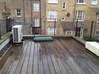 Roof terrace transformation:   by Paul Newman Landscapes