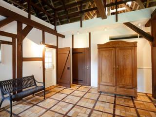 Fischerhaus Manhagen Flur, Diele & Treppenhaus im Landhausstil von Architekturbüro Griebel Landhaus