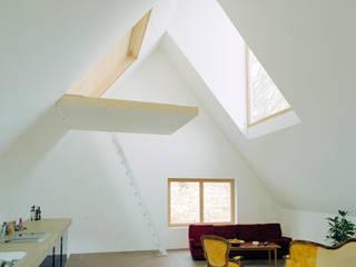 Modern living room by Jomini & Zimmermann Architekten Modern
